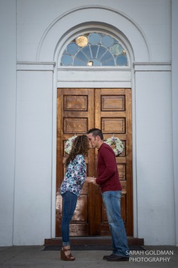 couple kissing in front of church on meeting street