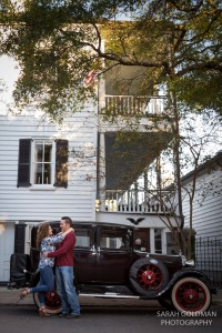 couple with old car in downtown charleston