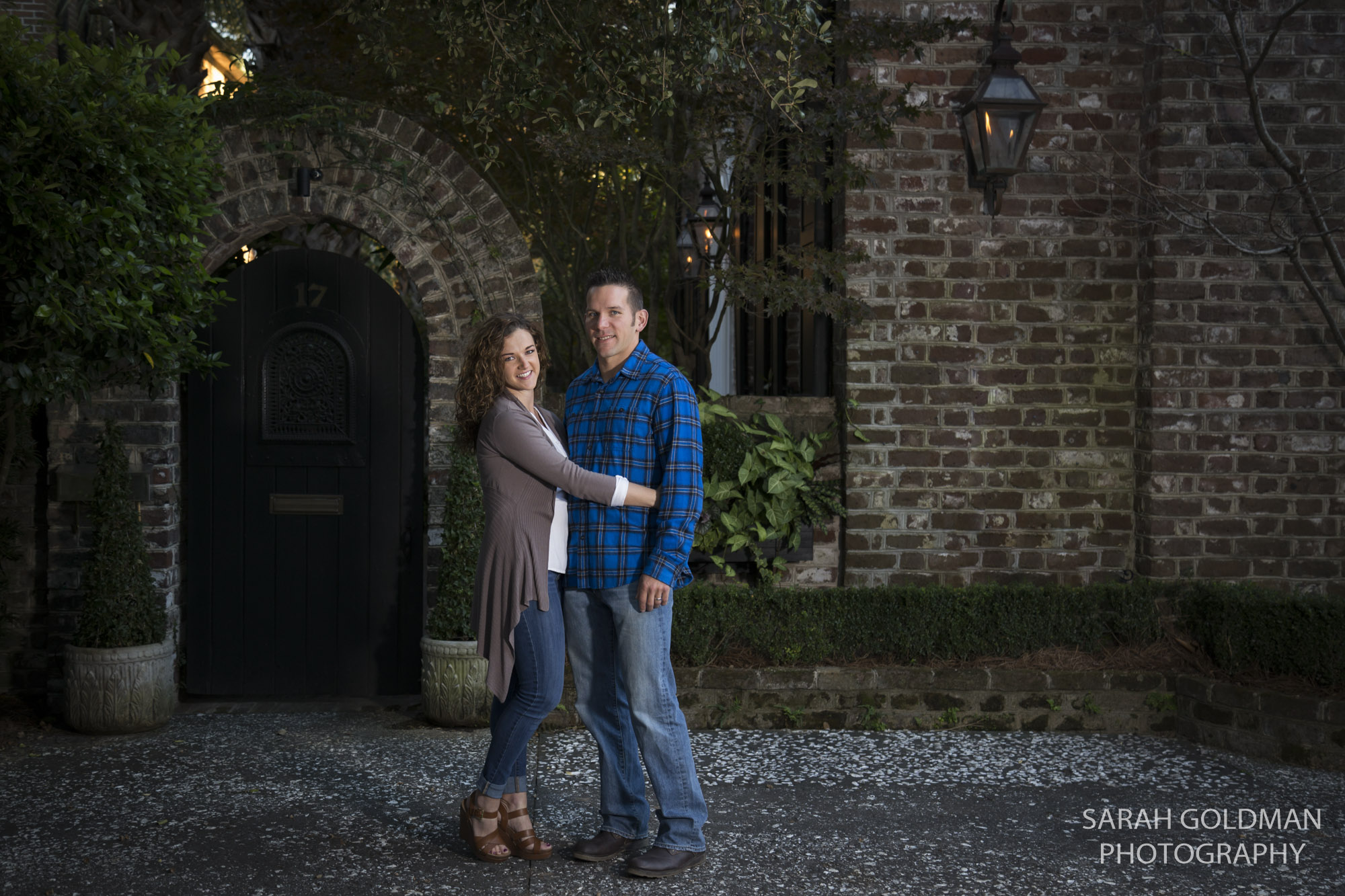 couple standing on old street in charleston sc