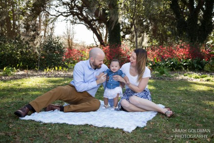 family sitting on a blanket in charleston