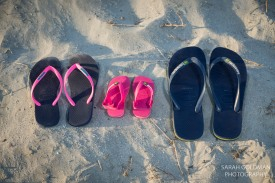 mom, dad, and baby flip flops