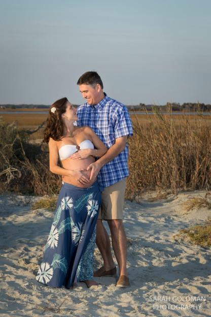 couple at folly beach during pregnancy shoot