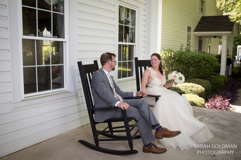 bride and groom sitting in rocking chairs at corley mill house