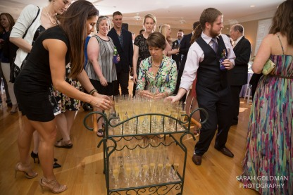 guests taking champagne at corley mill house reception