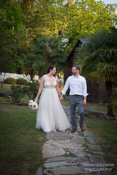 bride and groom on stone path