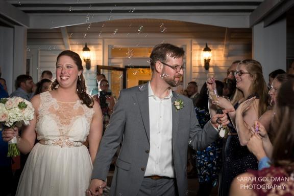 bride and groom exit through bubbles