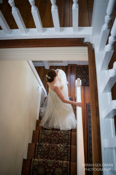 bride walking downstairs at corley mill house