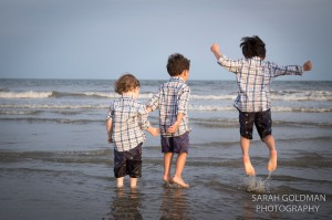 boys splashing in the waves
