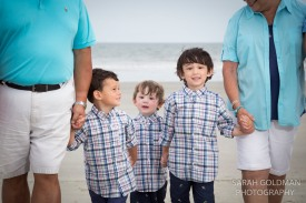 little boys on the beach with grandparents