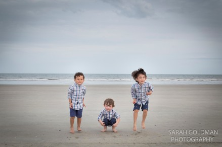 3 boys jumping on the beach