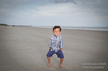 boy standing on the beach in charleston