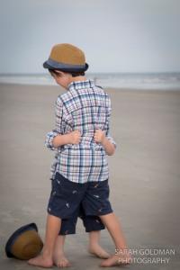 little boys hugging on the beach