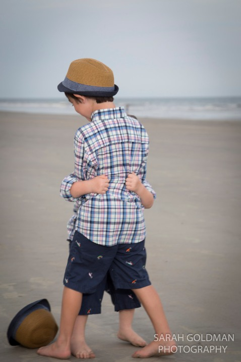 little boys hugging on the beach