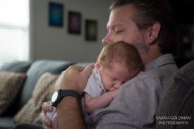 dad holding newborn son