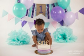 baby digging into cake