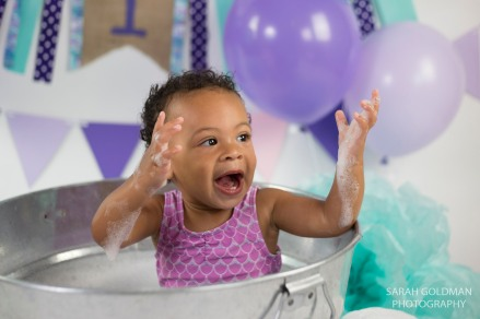 baby playing in bath tub during photo session on james island