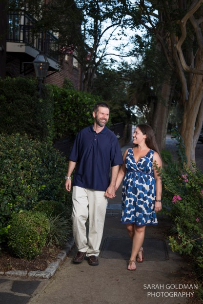 couple walking down street in charleston