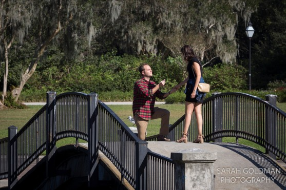 man proposing to his girlfriend on a bridge in charleston