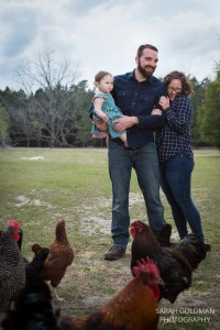 family with flock of chickens