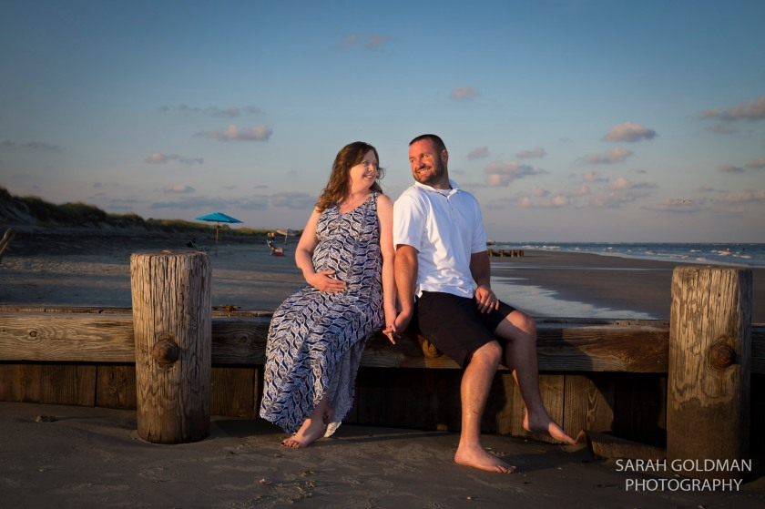 couple sitting on a dock folly beach sc