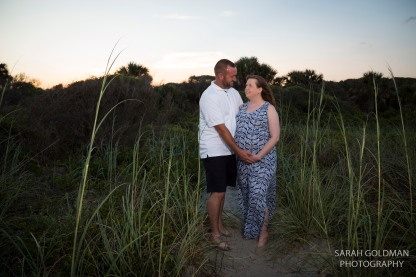 couple on folly beach during their maternity photos