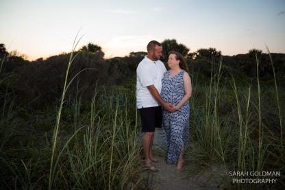 couple on folly beach during their maternity photos