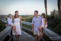 family on a boardwalk on Kiawah Island, South Carolina
