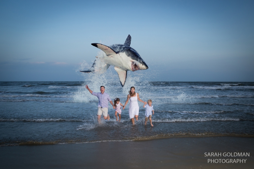 a photo of a family running from a great white shark